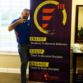 Man standing with custom retractable banner